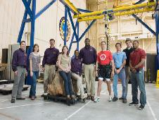 The Prairie View A&M senior design team (in purple) poses with the ARGOS team underneath the gravity