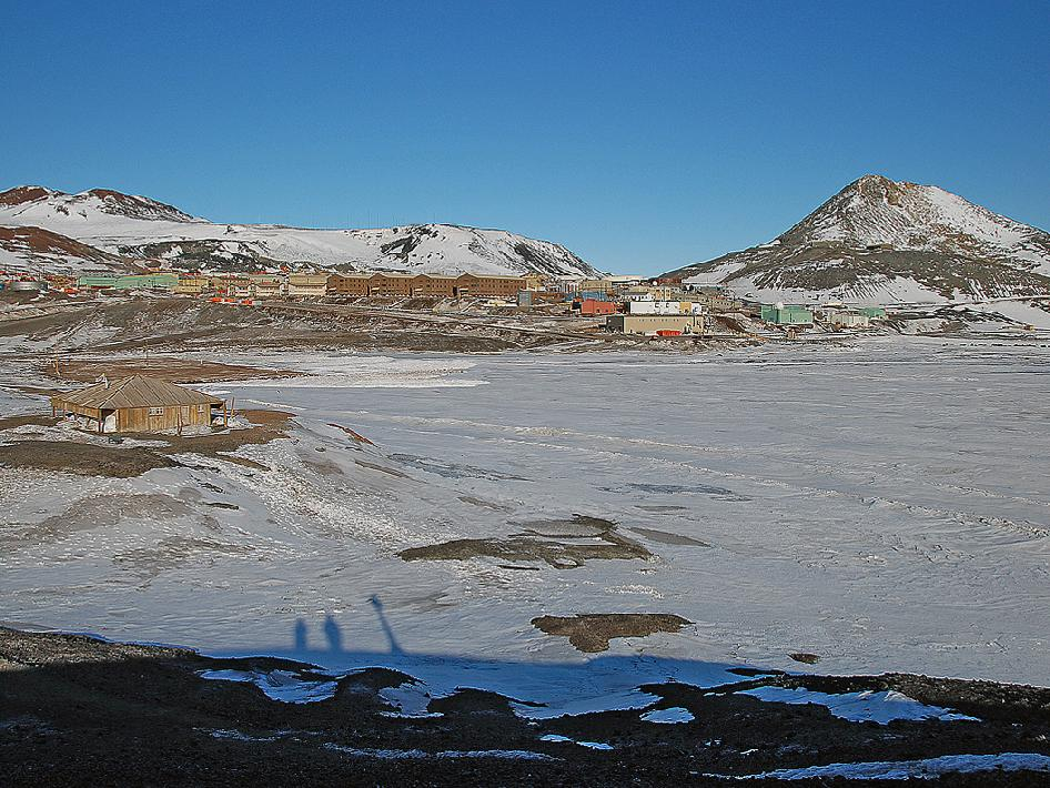 McMurdo Station in Antarctica with the historic Discovery Hut in the foreground.
