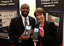 Leland Melvin and Malendy Lovett hold TI-Nspire devices