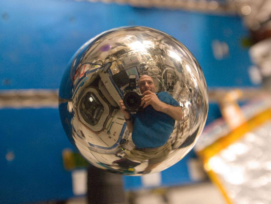 Reflection of astronaut Don Pettit