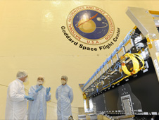NASA and JAXA personnel in the clean room with the DPR