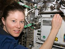 Astronaut Tracy Caldwell Dyson working at a Microgravity Experiment Research Locker Incubator, or MERLIN, aboard the International Space Station. (NASA)