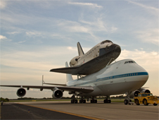 The Shuttle Carrier Aircraft and space shuttle Atlantis after landing at Kennedy Space Center