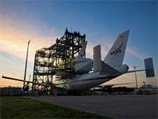 The Shuttle Carrier Aircraft and space shuttle Atlantis inside the mate-demate device at Kennedy