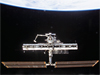 Space station in 2002 with one set of solar arrays and a nearly bare truss segment