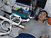 Astronaut Satoshi Furukawa prepares for an in-flight heart test