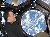 Ron Garan looks at Earth through a window in the Cupola