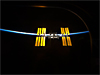 Space station against background of blackness of space and the thin line of Earth's atmosphere