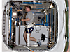 Astronaut Doug Wheelock runs on a treadmill, equipped with a bungee cord