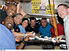 STS-129 crew poses in the galley of the Unity module on the space station
