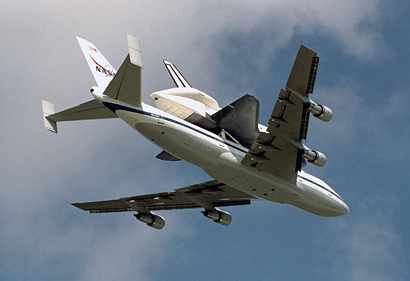 Endeavour passed over KSC's Shuttle Landing Facility atop NASA's Boeing 747 SCA as it returned March 27, 1997, from Palmdale, Calif.