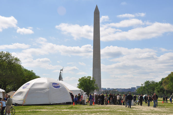 NASA tent on the National Mall with Washington Monument in background