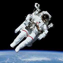 Astronaut Bruce McCandless II participating in a historic extravehicular activity.