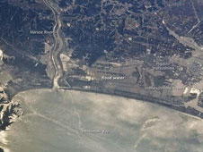 ISERV may provide important photographs to help with disaster aid and recovery, similar to this image take from the International Space Station of the Japanese coastline north and east of Sendai following inundation by a tsunami on Mar. 13, 2011.