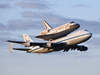 Secured to the Shuttle Carrier Aircraft, space shuttle Discovery departs Kennedy Space Center