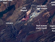 This Crew Earth Observation photograph highlights classical geological structures associated with a tectonic rift valley, in this case the Eastern Branch of the East African Rift near Kenya's southern border with Tanzania and just south of the Equator. (NASA)
