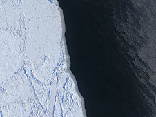 The margin of a large lead of open water (dark) and thin grease ice (gray, right) in the Chukchi Sea between Alaska and Russia
