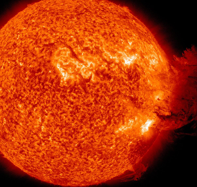 An SDO image captured on June 7, 2011, during which an eruption of solar material mushroomed up and fell down to what appeared to be nearly half the sun's surface.
