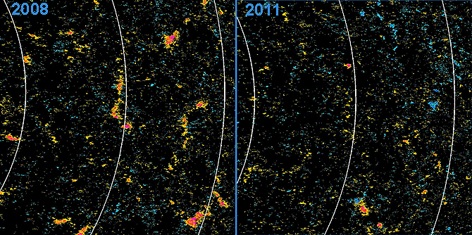 In 2008 in the northern hemisphere of the sun (left) Hinode observed large patches of negative polarity, shown in orange.  In 2011 (right), the same area showed much smaller patches and a more even distribution of negative and positive (blue) regions.
