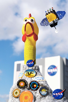 SDO mascot, Camilla (rubber chicken) and Little SDO in front of Vehicle Assembly Building (VAB).