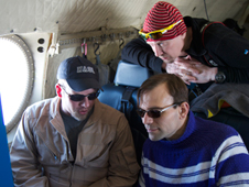 The DMS expert explains the instrument to teachers-in-the-field accompanying the IceBridge flight.