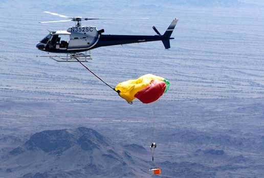 helicopter practices retrieving mock sample return capsule