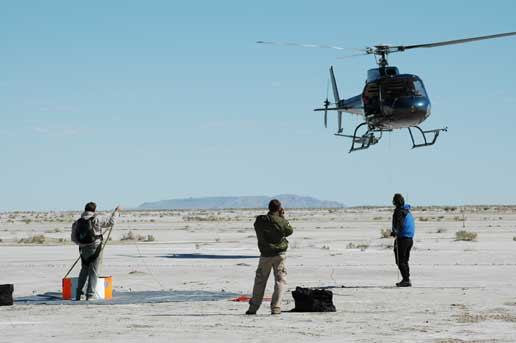 helicopter practices bringing mock return capsule to the ground