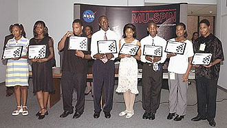 Students from Drew Freeman Middle School holding certificates they received from the Minority University-Space Interdisciplinary Network.