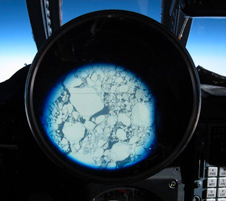 The partially broken sea ice pack below NASA's ER-2 can be clearly seen through the pilot's cockpit viewing sight during one of the MABEL laser altimeter validation flights.