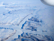 The convergence of two glaciers near Thule, Greenland can be seen in this photo from the cockpit of NASA's ER-2 Earth Resources aircraft during a MABEL laser altimeter validation flight.
