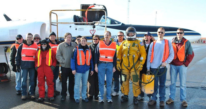 The flight, ground and science team that supported the MABEL laser altimeter validation flights over Greenland gathered by NASA's ER-2 for a group photo before pilot Stu Broce (in pressure suit) took the aircraft aloft on its return flight from Keflavik, Iceland to Palmdale, Calif. April 27.