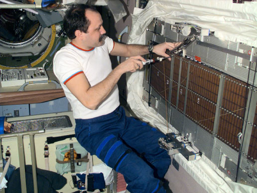 Cosmonaut Yury V. Usachev, Expedition Two commander representing Rosaviakosmos, conducts maintenance on the Treadmill Vibration Isolation System in the Zvezda/Service Module.