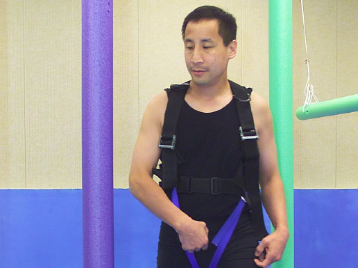 Astronaut Edward T. Lu walks through obstacle course for the Functional Mobility Test.