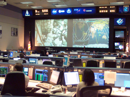 This overall view of the station flight control room in Johnson Space Center's Mission Control Center (MCC) was photographed during rendezvous and docking operations between the Soyuz TMA-3 spacecraft and the International Space Station.