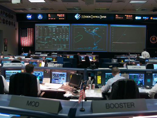 An overall view of the shuttle flight control room in Houston's Mission Control Center .