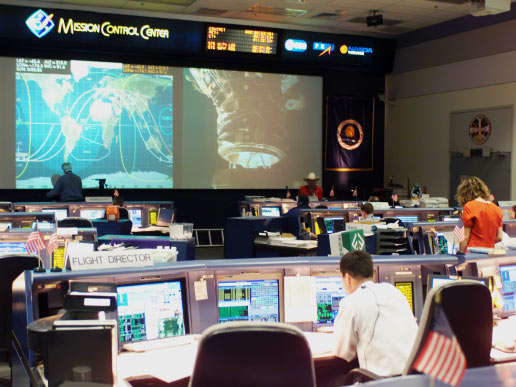 In this overall view of the shuttle flight control room in Houston's Mission Control Center , the docking of the Space Shuttle Endeavour and the International Space Station is shown on the big screen.