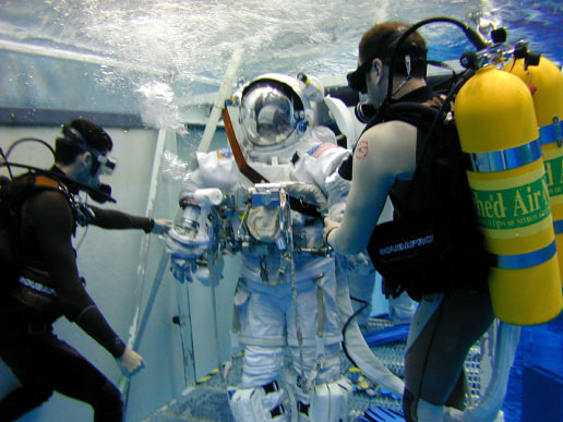 Astronaut Barbara R. Morgan, wearing a training version of the Extravehicular Mobility Unit spacesuit, participates in an underwater simulation of extravehicular activity at the Neutral Buoyancy Laboratory near Johnson Space Center.