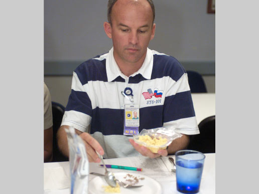 Astronaut Jeffrey N. Williams participates in food tasting in the Flight Projects Division Laboratory at the Johnson Space Center.