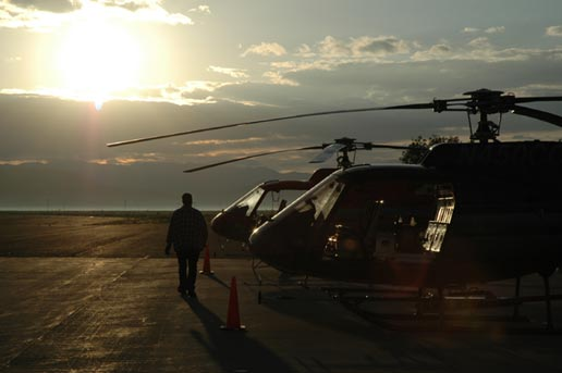 A Genesis ground crewman inspects the two Genesis capture helicopters