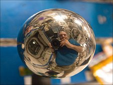 A close look at this four-inch polished metal sphere onboard the International Space Station reveals a reflected image of NASA astronaut Don Pettit. (NASA)