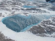 Frozen melt-water lake along the northeast Greenland coast.