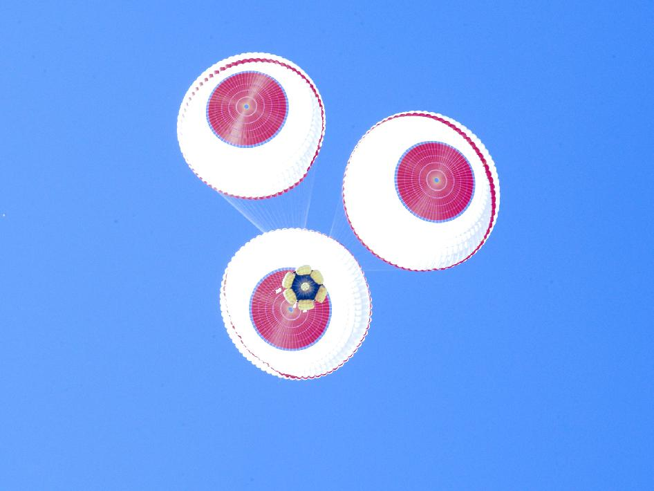 The main parachutes deploy for Boeing's CST-100 crew capsule during a parachute drop test on May 2, 2012.