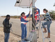 NASA personnel install a sonic boom sensor in a residential community for tests last year that remotely measured sonic boom levels. The data is helping researchers determine an acceptable level for sonic booms heard over land.