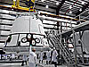 SpaceX's Dragon capsule is lifted inside a processing hangar at Cape Canaveral Air Force Station