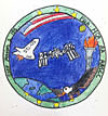 Patch with student's drawing of space shuttle, space station, lighted torch, eagle and Earth below