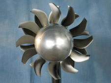 In an open rotor engine, one high-speed propeller spins in one direction while another directly behind it spins in the other direction. The engine shows promise in reducing fuel use and emissions without sacrificing power.