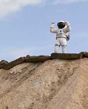 Engineer stands atop a hill in test gear