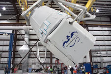 The SpaceX Dragon capsule in processing.