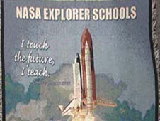 Front of the NASA Explorer Schools cotton throw featuring an image of a shuttle at liftoff
