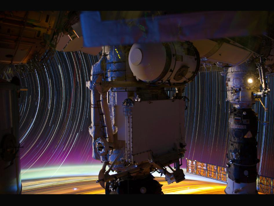 Image of the Day Gallery: Psychedelic Space Redux: This is a composite of a series of images photographed from a mounted camera on the Earth-orbiting International Space Station, from approximately 240 miles above Earth.